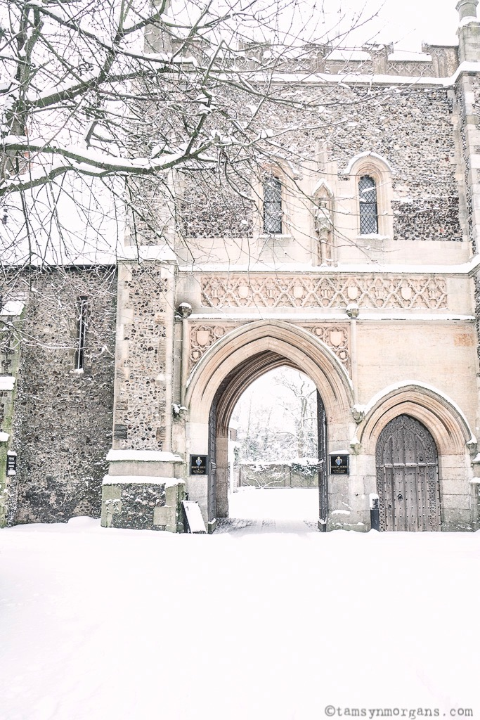 Part of Norwich Cathedral in the snow