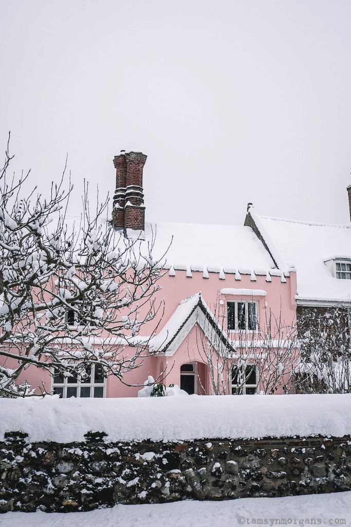 The prettiest pink house in Cathedral Close, Norwich, in the snow.